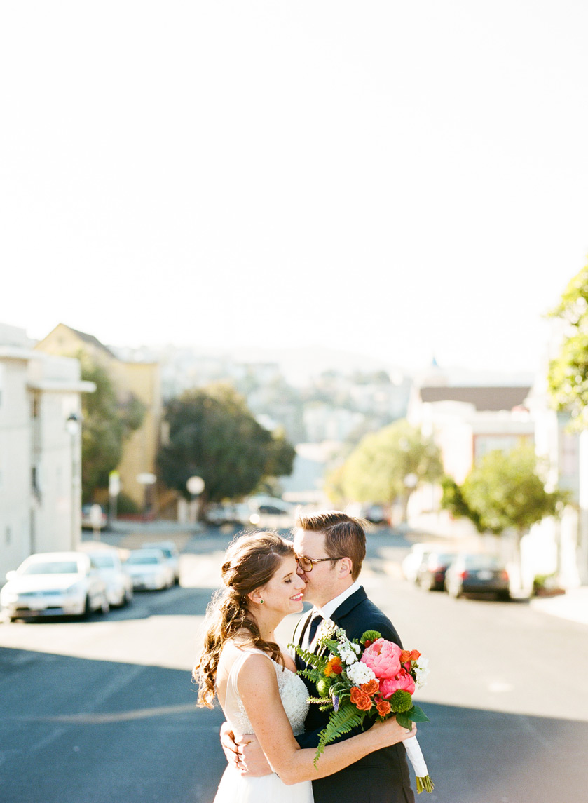 Just married couple embrace in San Francisco