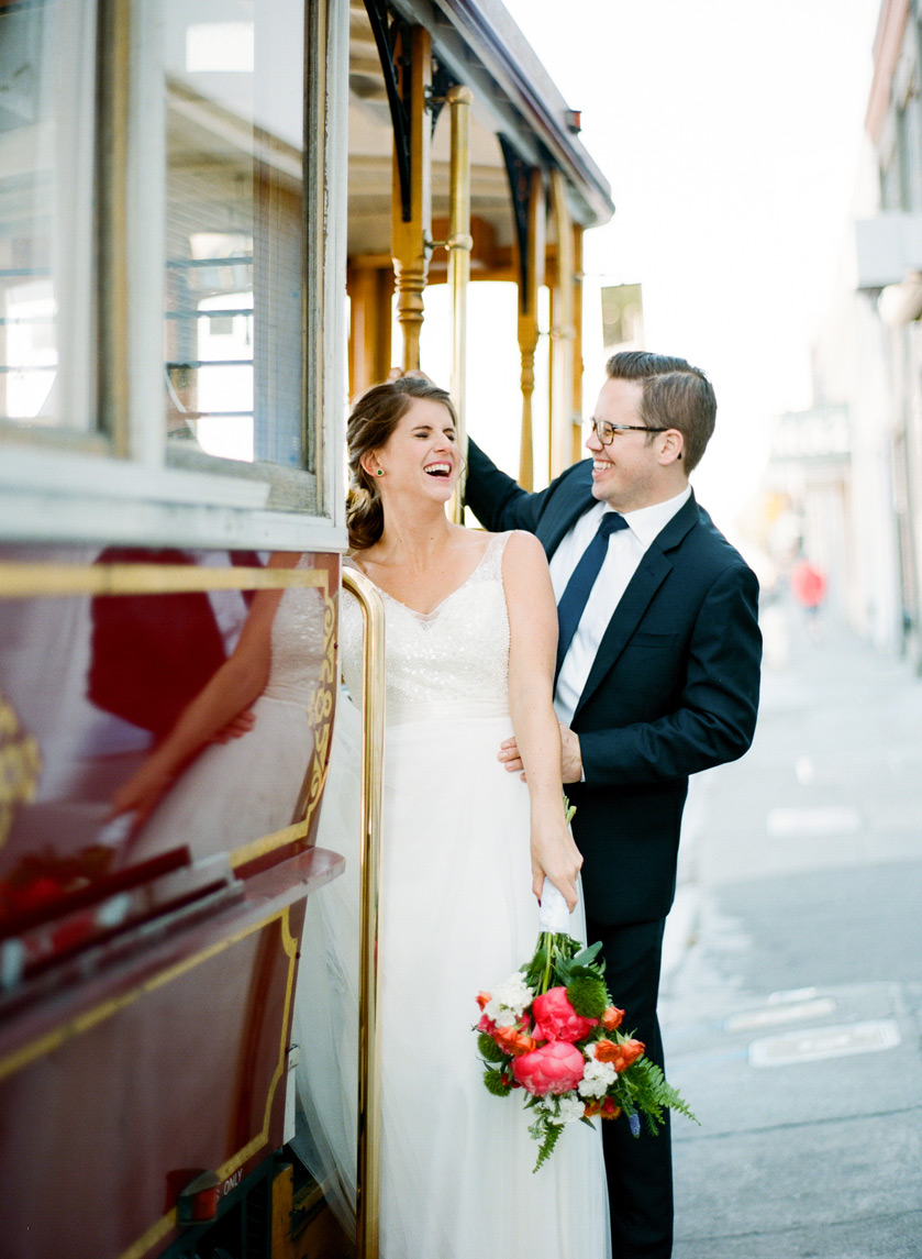 A couple board a trolley in San Francisco before their Terra Gallery Wedding reception